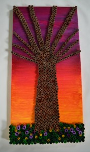 Eco Tree is made with cardboard tubes that were rolled up into spirals. The background is acrylic paint.